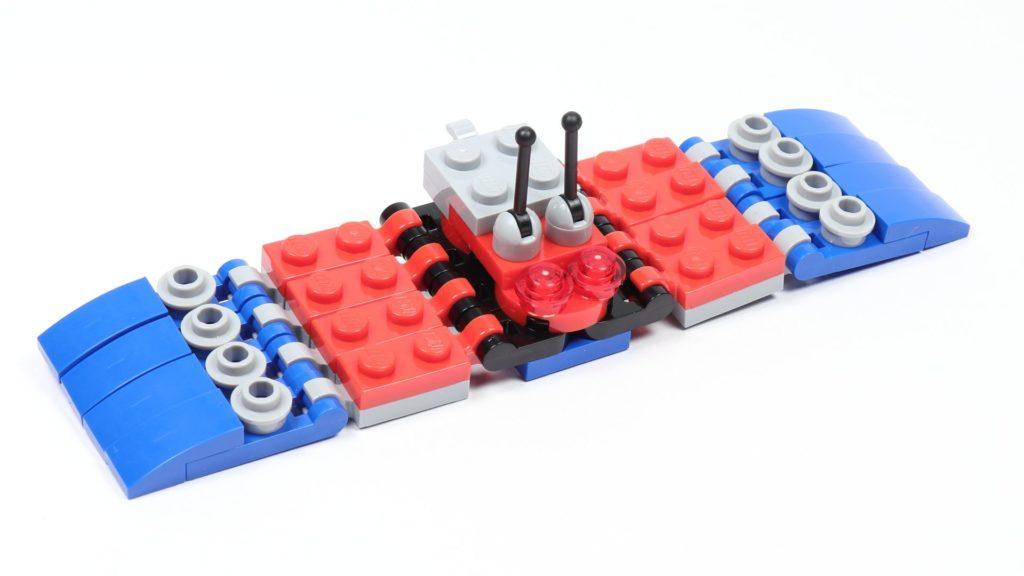 LEGO® Marvel 30451 Spider-Mans Mini Spider Crawler - Beine befestigt, vorne | ©2019 Brickzeit